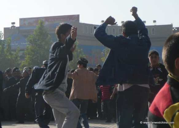A spirited Uyghur dance in the streets of Kashgar, Xinjiang