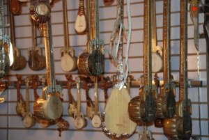 Uyghur musical instruments hanging in a market