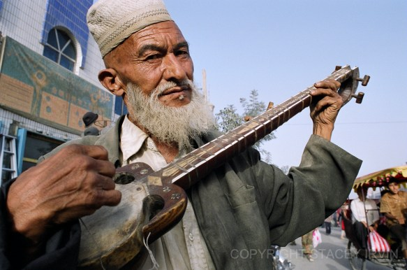A Uyghur man from Xinjiang plays the Rawap
