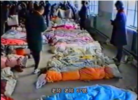 Bodies wrapped after the Dec 8, 1994 Karamay fire in Xinjiang, China