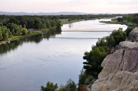 A wooden bridge crosses the Irtysh River (Ertix) in Xinjiang, China