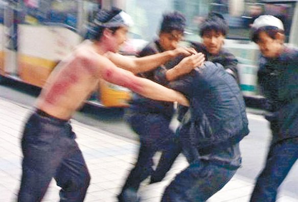 Young men attacking each other in the streets of Korla, Xinjiang