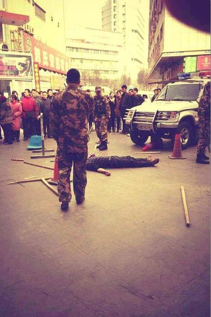 A body lies dead in the streets of Korla, Xinjiang
