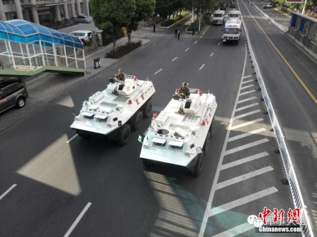 A parade of troops through downtown Urumqi in Xinjiang on May 24, 2014