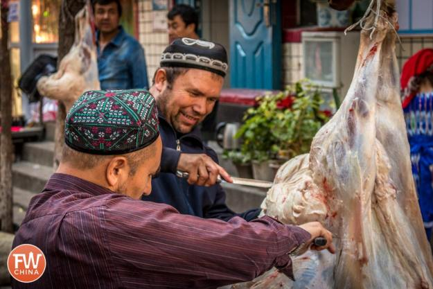 Uyghur men butchering sheep in Urumqi, Xinjiang