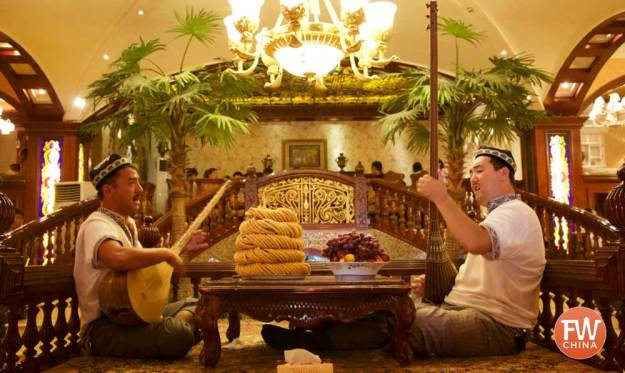 Two Uyghur playing dutars in a restaurant in Kashgar, Xinjiang