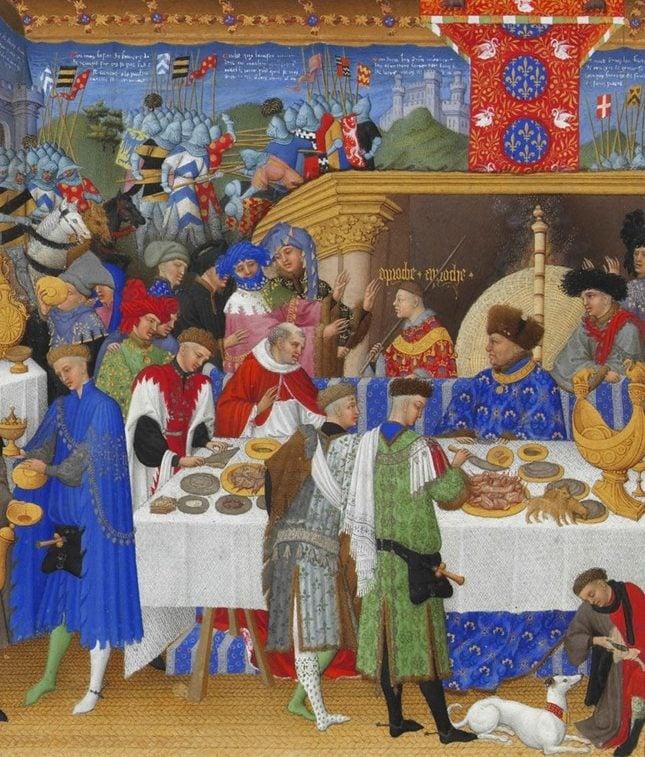 Cena medieval de um banquete e batalha