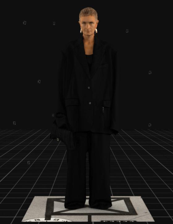 Modelo usa conjunto alfaiataria preto