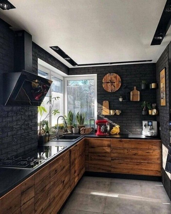 Decoração rústica em cozinha com paredes pretas.