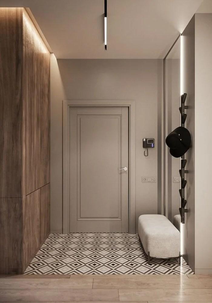 Hall de entrada com parede de madeira.