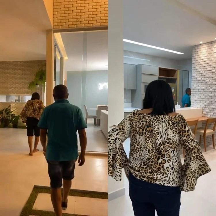 Foto de Maria e Virgílio conhecendo o novo lar.