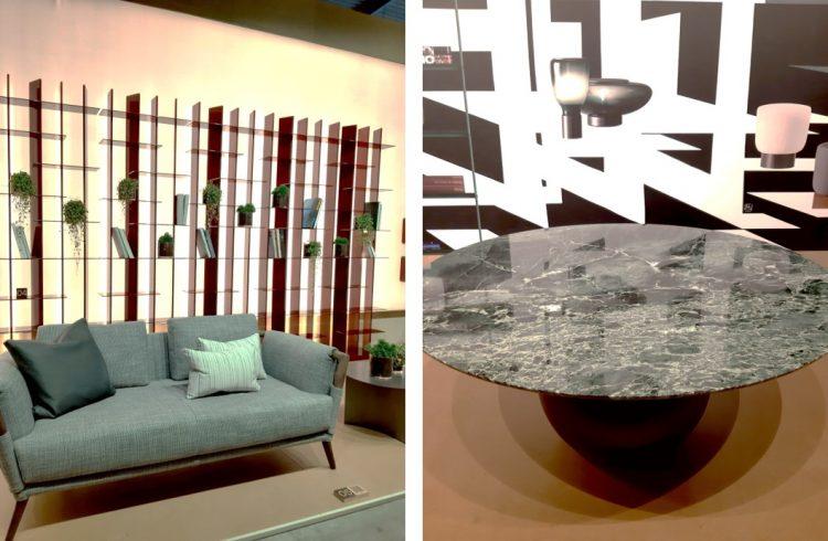ambiente do salão de móveis de Milão com estante e nichos geométricos, sofá em estofado verde e mesa com tampo de pedra verde