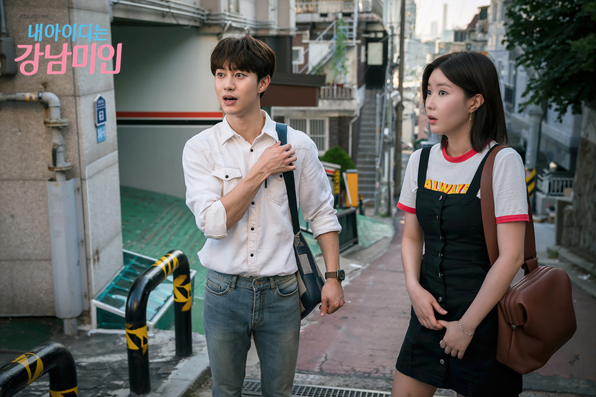 Gangnam beauty Kang Mi Rae black dress with white graphic T-shirt beneath