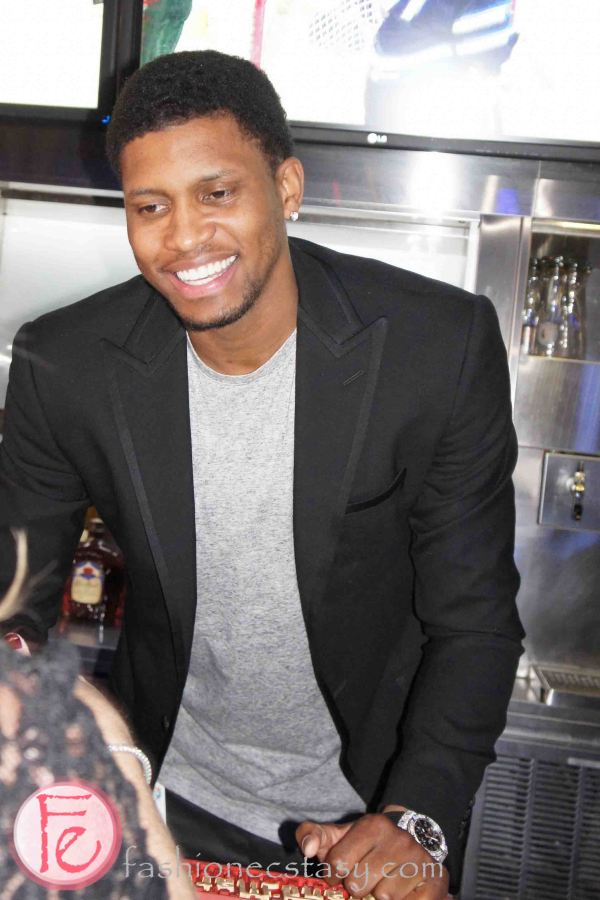 Rudy Gay serving drinks as bartender