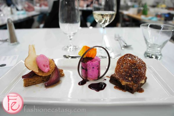 dessert trio- chai spiced honey cake poached pear with raspberry sorbet, layers of oatmeal dacquoise blackberry ice cooler, bittersweet marjolaine with hazelnut parfait