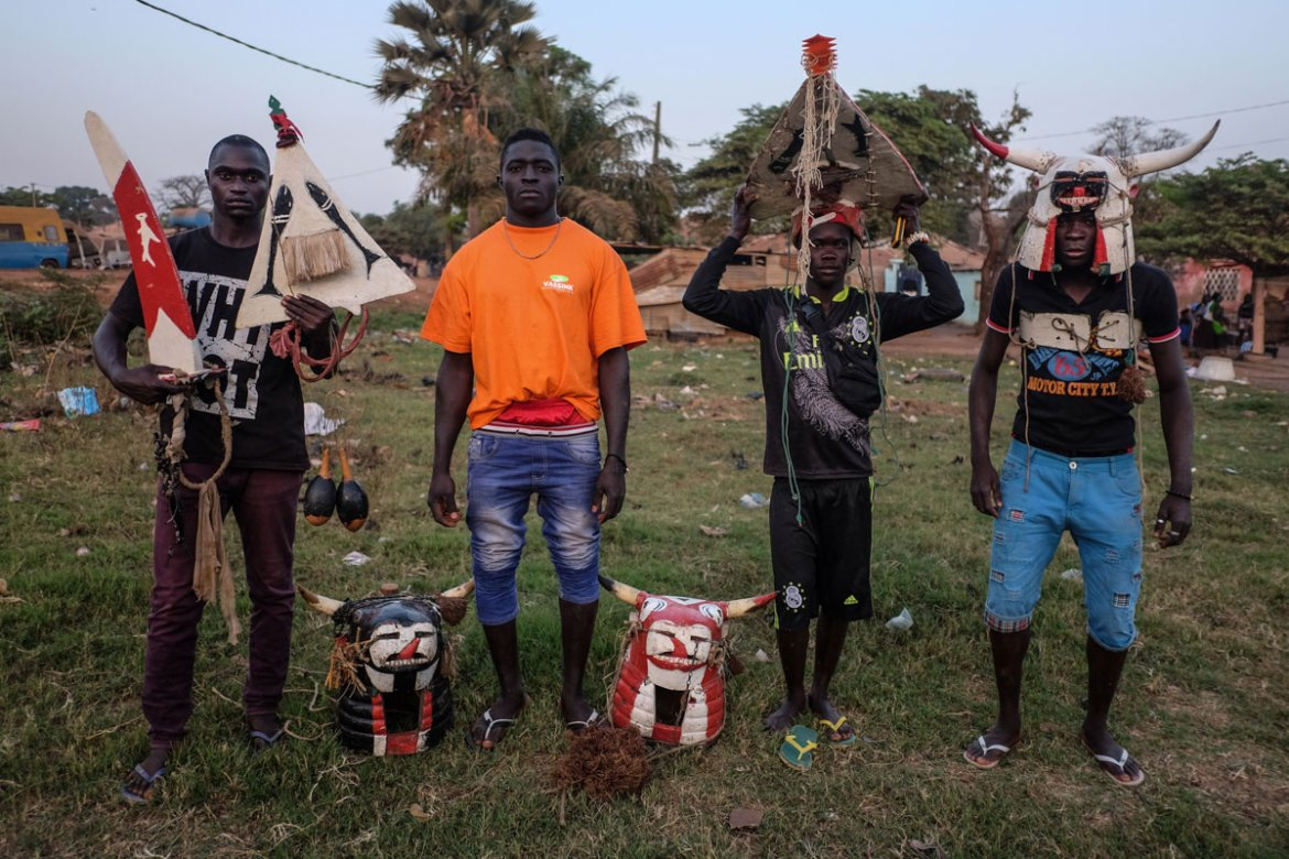 Sene, Aliu, Mamdou and Jonas, from the Bijagos island chain off of Guinea Bissau, pose with their traditional costumes for the Fanado ceremonies on their islands. The ceremony is to celebrate a man's coming of age. [Ricci Shryock/Al Jazeera]