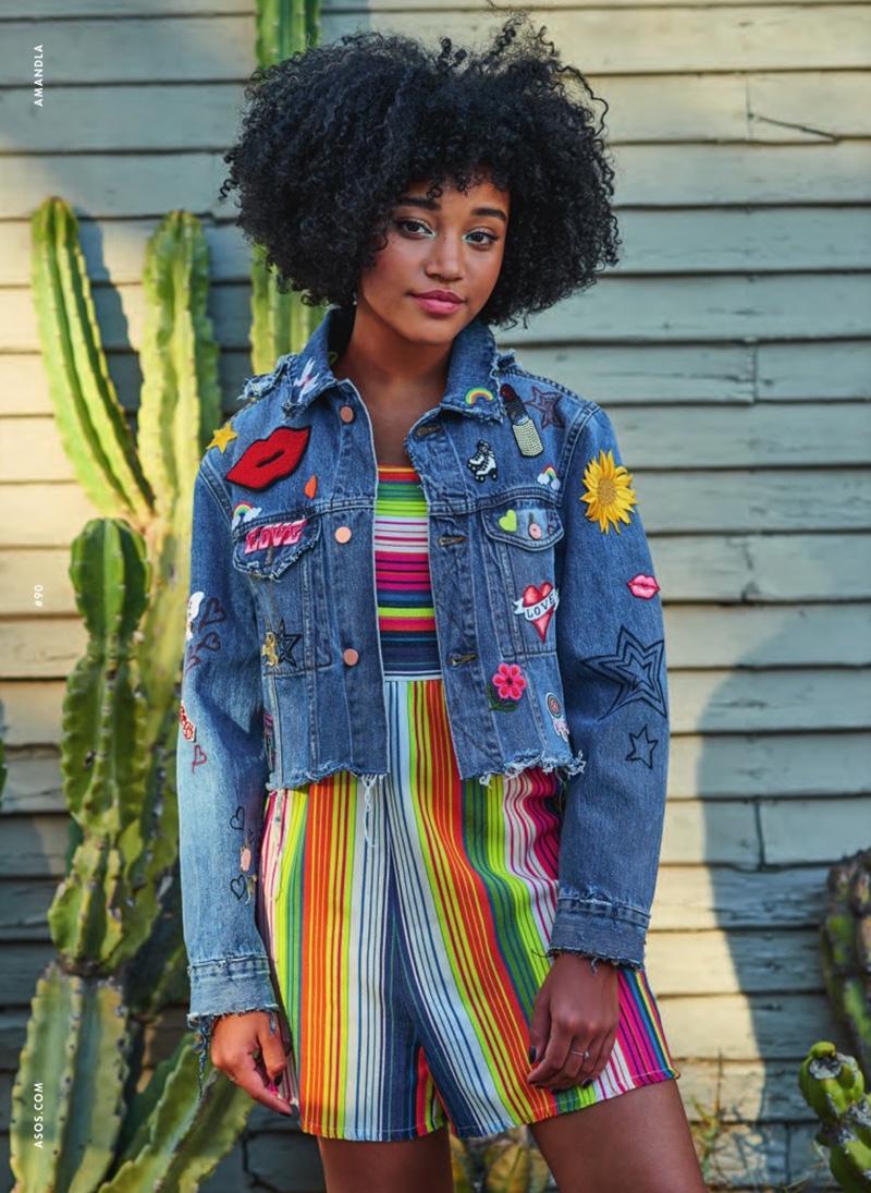Amandla poses in customized denim jacket and rainbow romper from ASOS