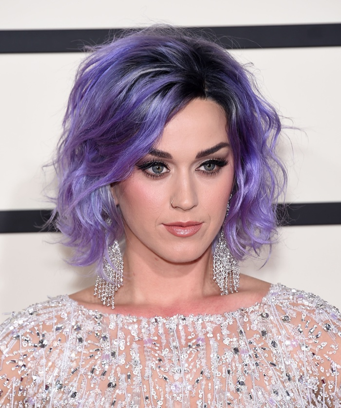 Katy Perry rocks a short and wavy purple hairstyle at the 2015 Grammy Awards. Photo: DFree / Shutterstock.com