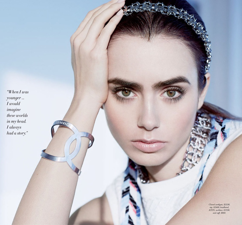 Lily Collins shows off a bracelet featuring the Chanel interlocking C logo