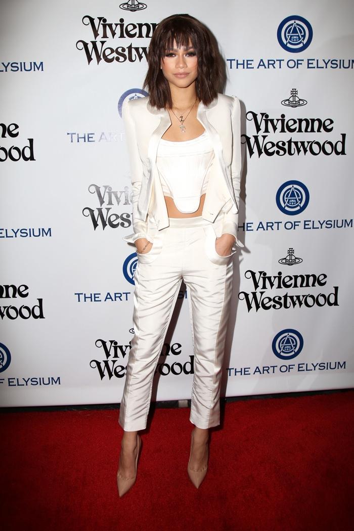 JANUARY 2016: Zendaya at the The Art of Elysium 2016 Heaven Gala wearing a white pantsuit. Photo: Helga Esteb / Shutterstock.com
