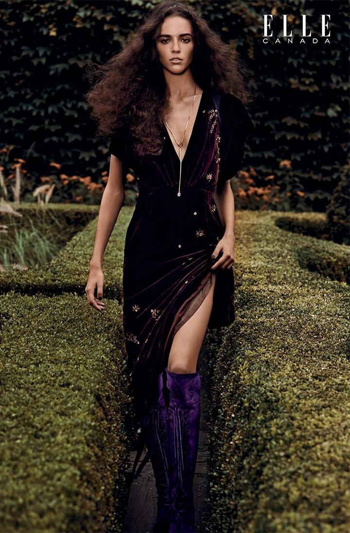 Serving 70's vibes, Emm Arruda models Prada velvet dress and harness with velvet boots