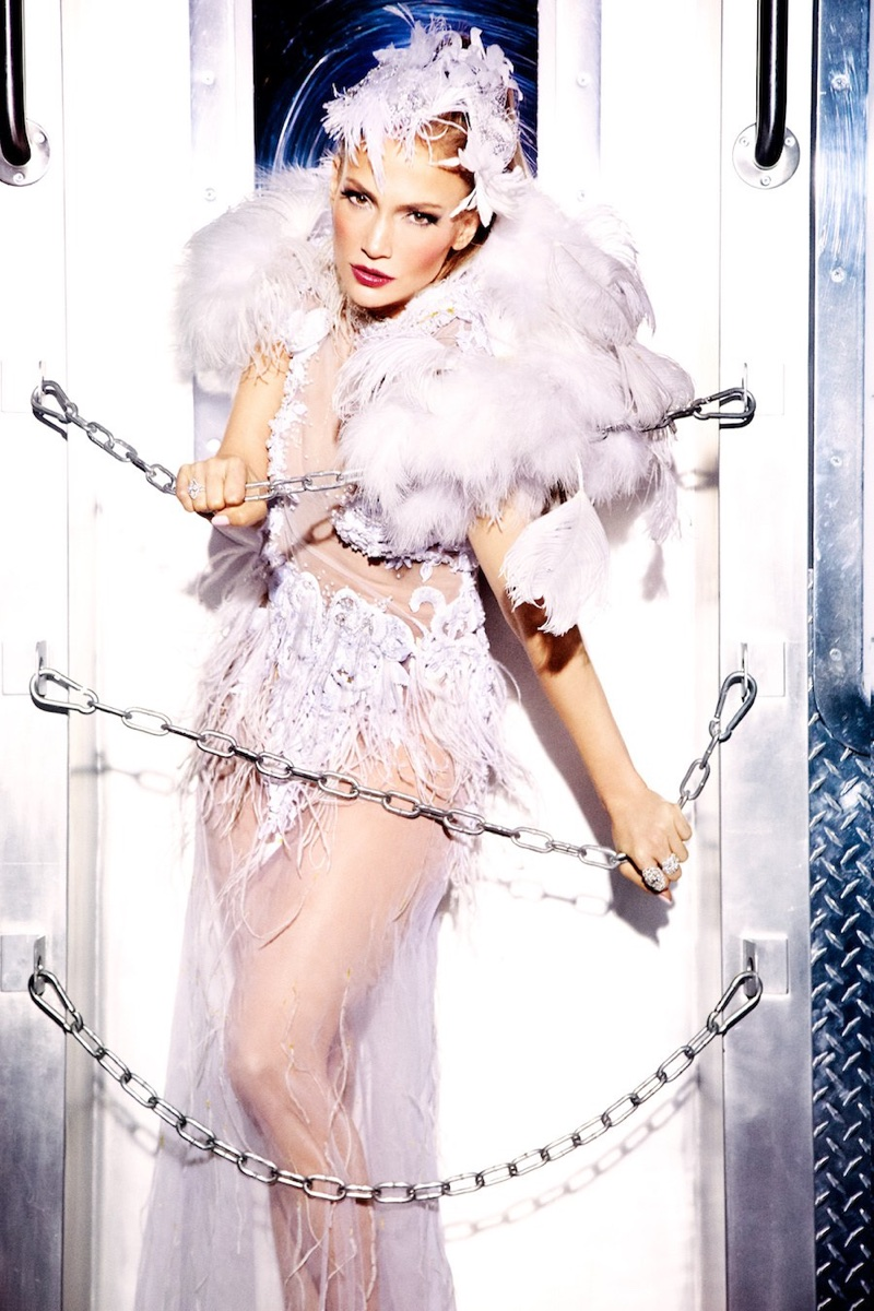 Looking like a Las Vegas showgirl, Jennifer Lopez wears Rocky Gathercole dress and Maria Elena headpiece