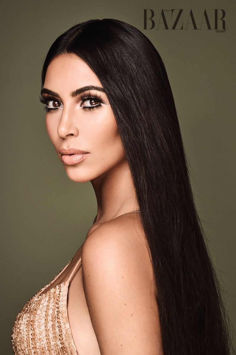 Wearing a long and straight hairstyle, Kim Kardashian poses in Dilek Hanif dress