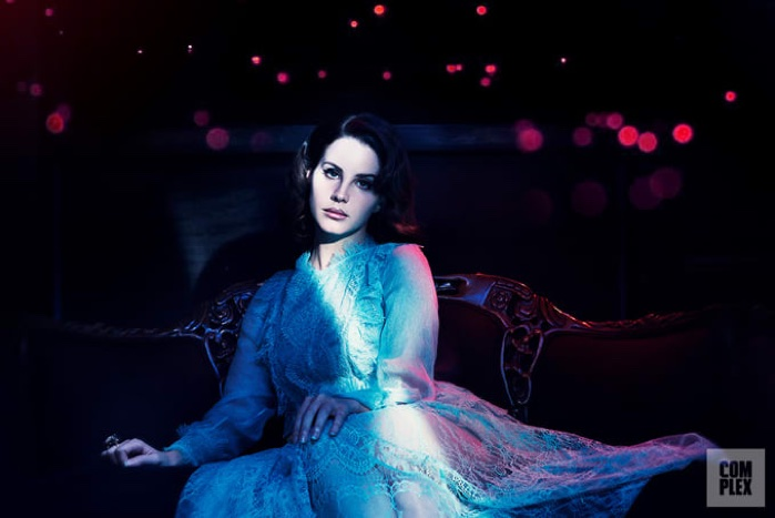 Embracing lace, Lana Del Rey poses in Maria Lucia Hohan dress