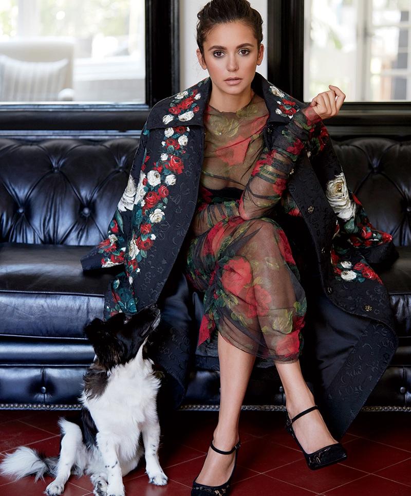 Striking a pose, Nina Dobrev wears Dolce & Gabbana dress, coat and heels