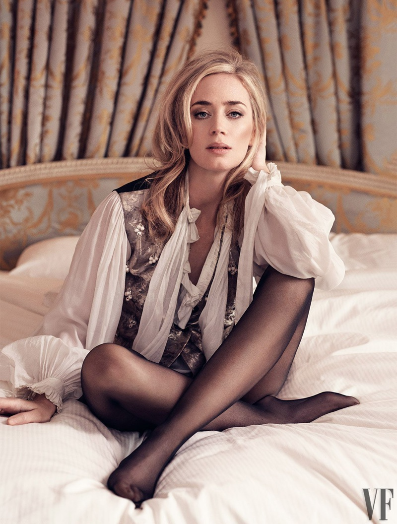 Posing in bed, Emily Blunt wears Louis Vuitton vest and blouse