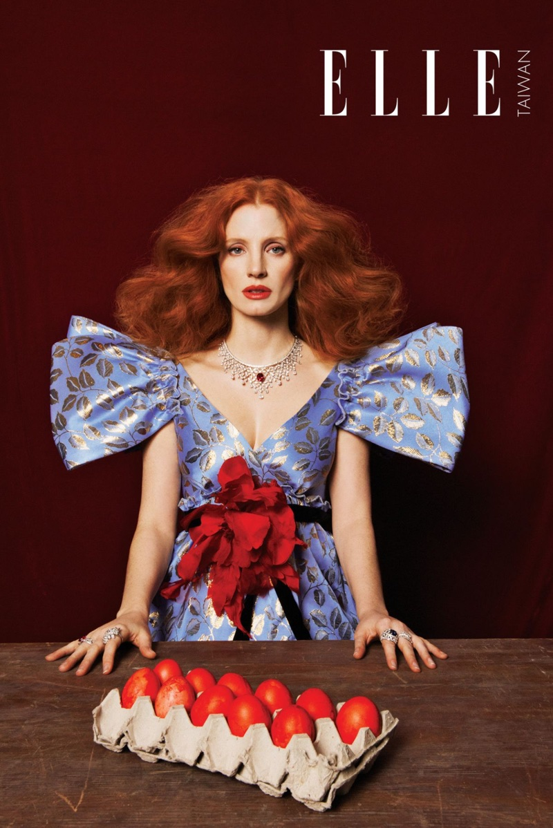 Actress Jessica Chastain poses in embroidered Gucci dress