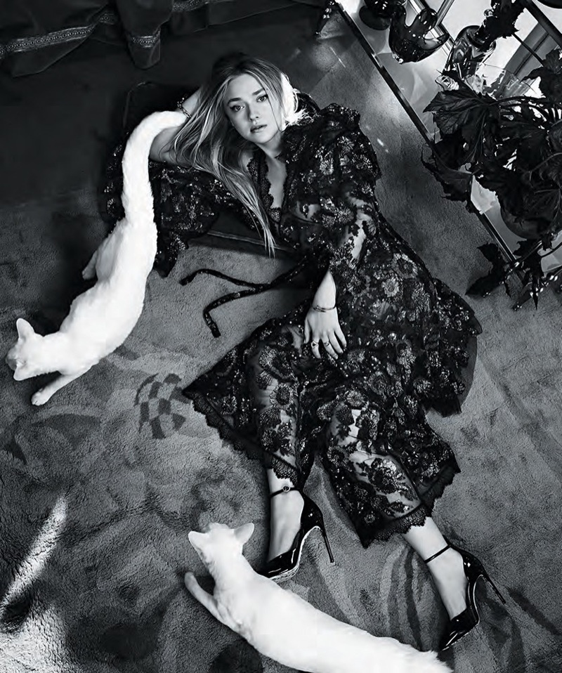 Photographed in black and white, Dakota Fanning wears embroidered gown