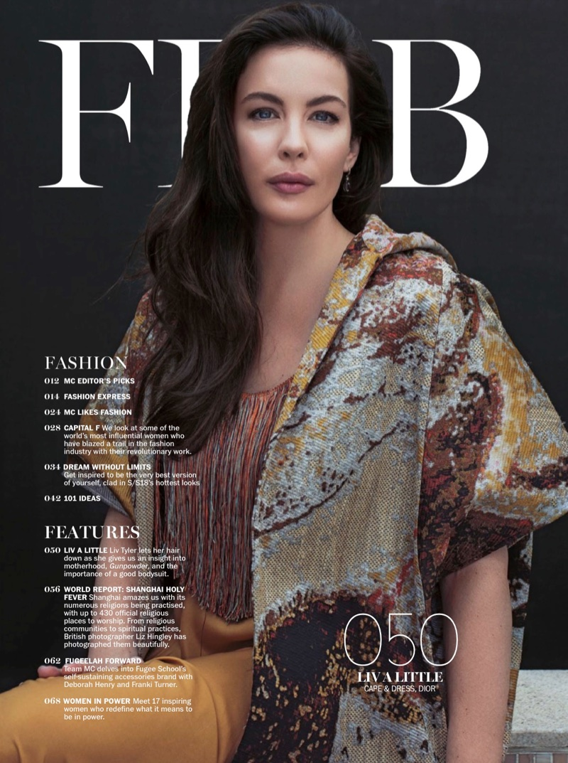 Actress Liv Tyler poses in Dior cape and dress