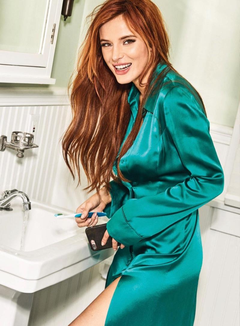 Flashing a smile, Bella Thorne wears green Galvan dress