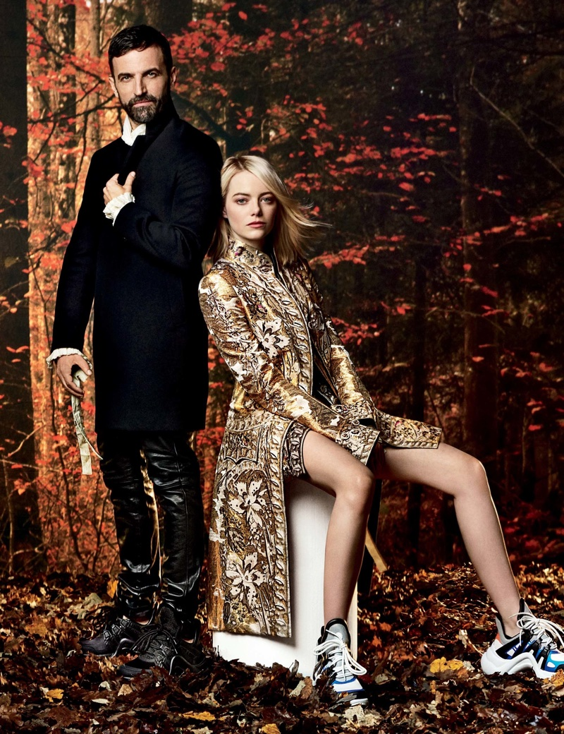 Wearing Louis Vuitton, Emma Stone poses with the brand's creative director Nicolas Ghesquière