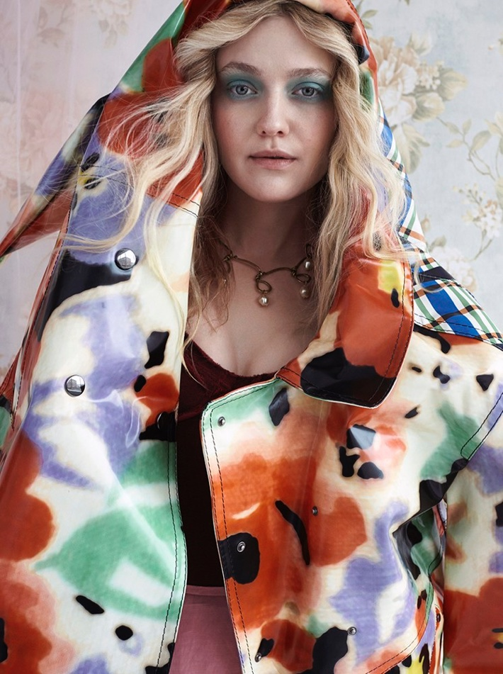 Actress Dakota Fanning poses in multi-colored jacket from Marni with JW Anderson separates