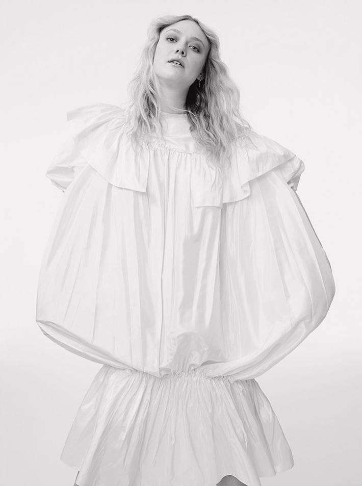 Actress Dakota Fanning poses in ruffled dress from Simone Rocha