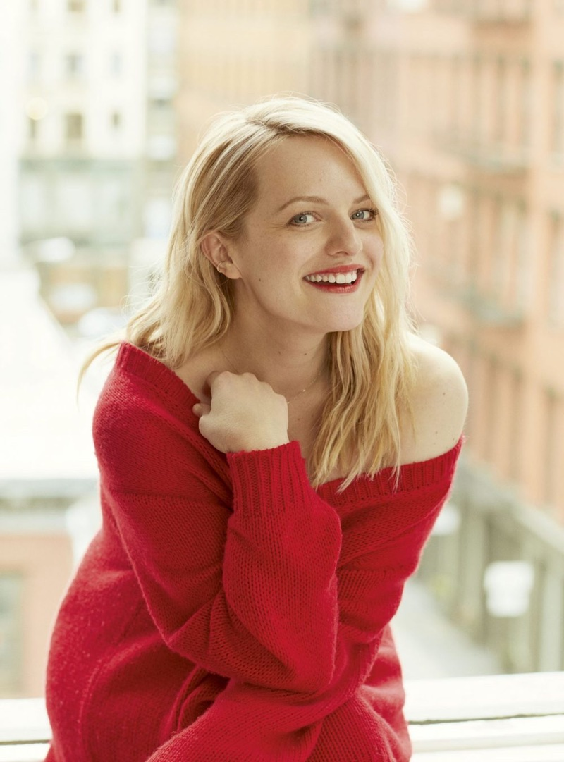 Actress Elisabeth Moss poses in red Dior sweater