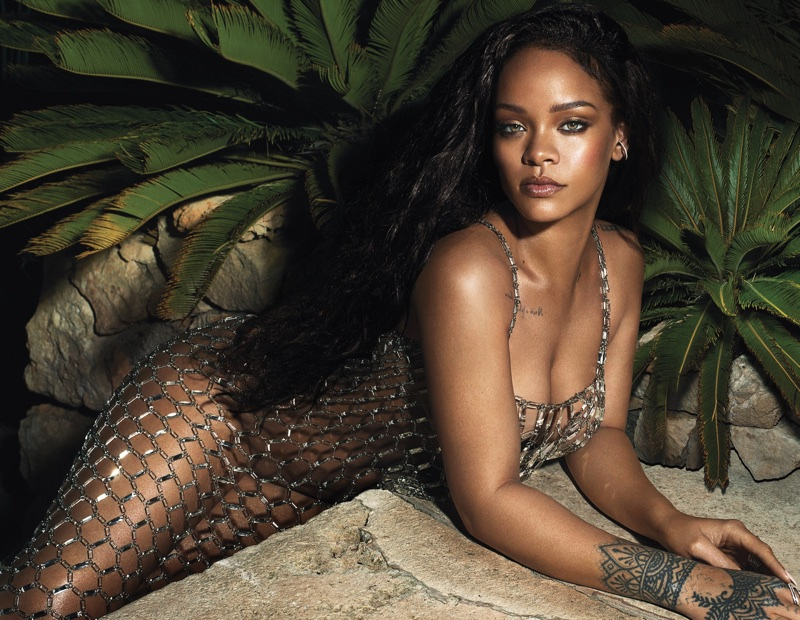 Singer Rihanna poses in Paco Rabanne dress with Lynn Ban ear cuff and ring