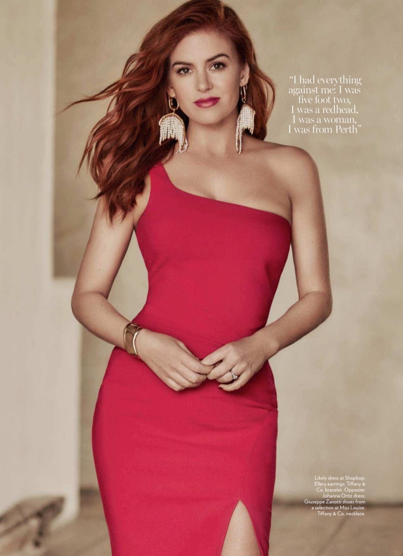 Isla Fisher poses in Likely dress, Ellery earrings and Tiffany & Co. bracelet