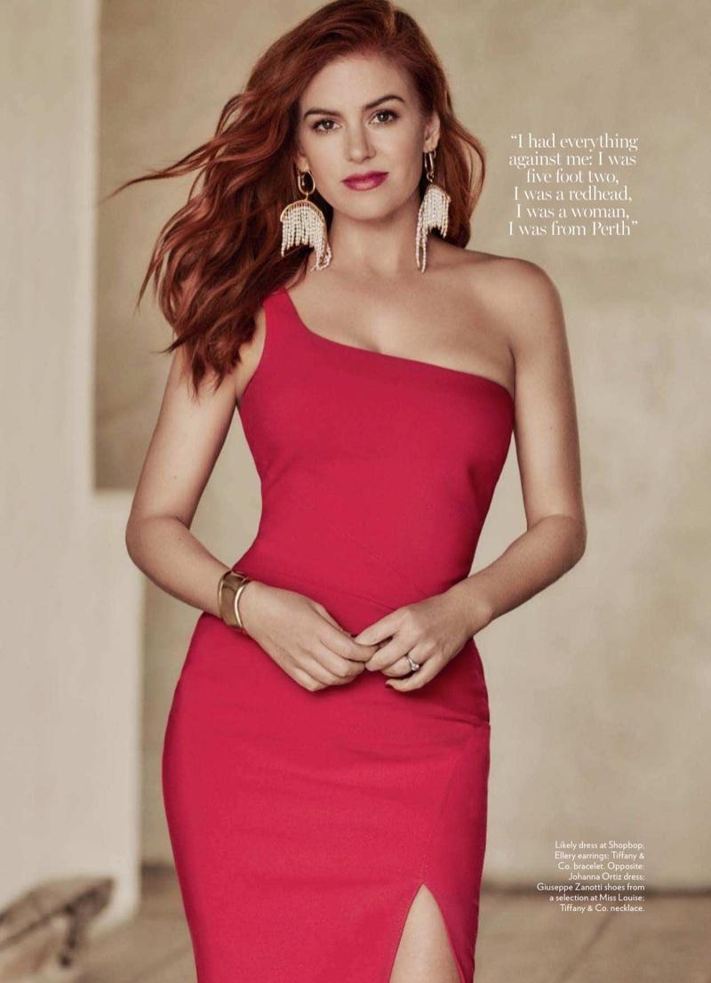 Isla Fisher poses in Likely dress, Ellery earrings and Tiffany & Co. bracelet