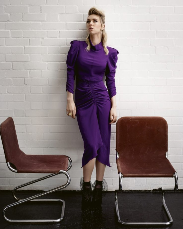 Vanessa Kirby poses in purple dress with ruching