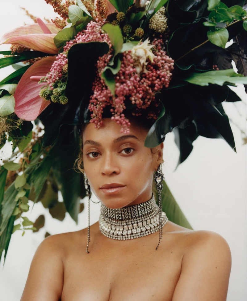 Singer Beyonce wears Phil John Perry for Rebel Rebel floral headdress, Erickson Beamon earrings and Lynn Ban necklaces