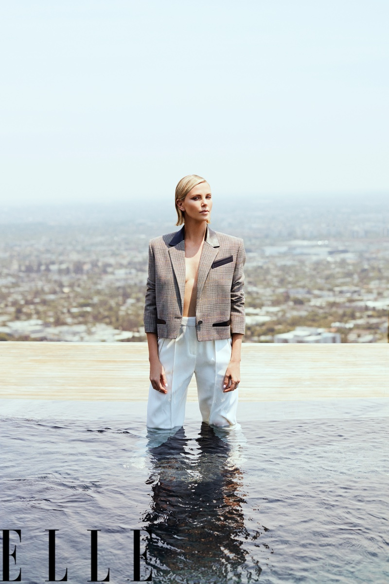Charlize Theron wears Louis Vuitton jacket and pants
