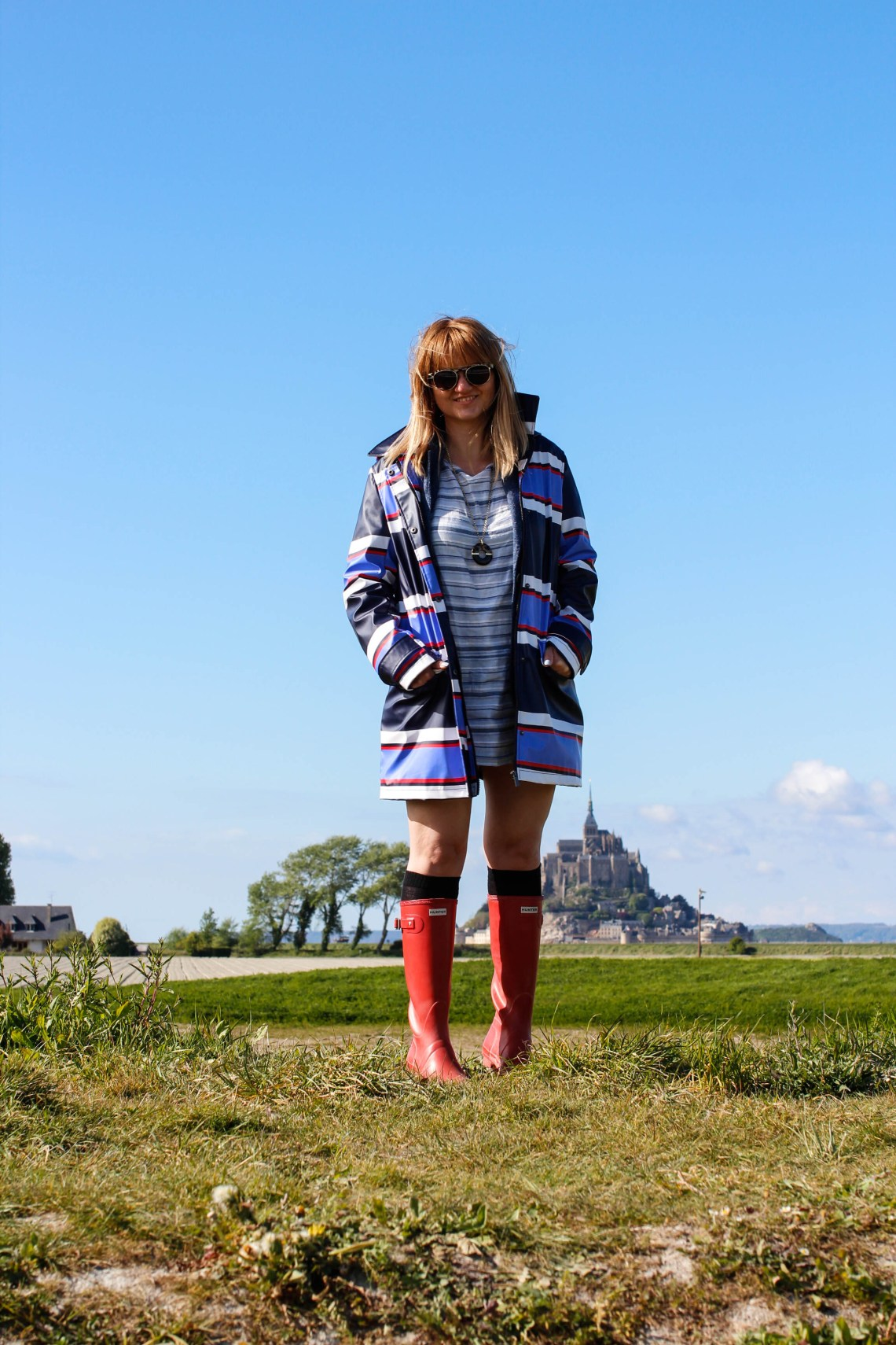 raincoat and hunter red boots mont-saint-michel normandy