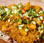 Curried aloo chicken with rice and peas