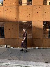 Blogger Pixie Tenenbaum showcasing a prairie girl style dress with flat boots