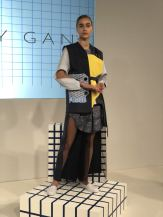 Cassey Gan FW18 London fashion Week full length image of one model wearing an asymmetric coat in blue and yellow shades
