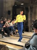 STARSICA FW18 LONDON FASHION WEEK a model wears blue pants and a yellow jumper