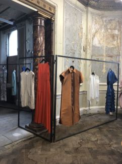 Merchant Archive FW18 a static presentation of garments on a cubed rail